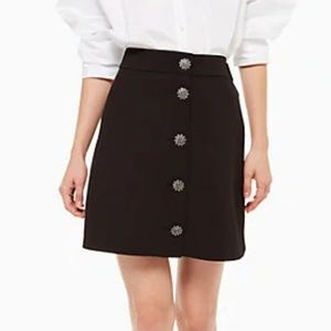 black mini skirt with front jeweled buttons